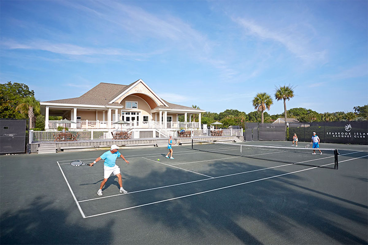 adults playing tennis for snowbird tennis on seabrook island clay courts