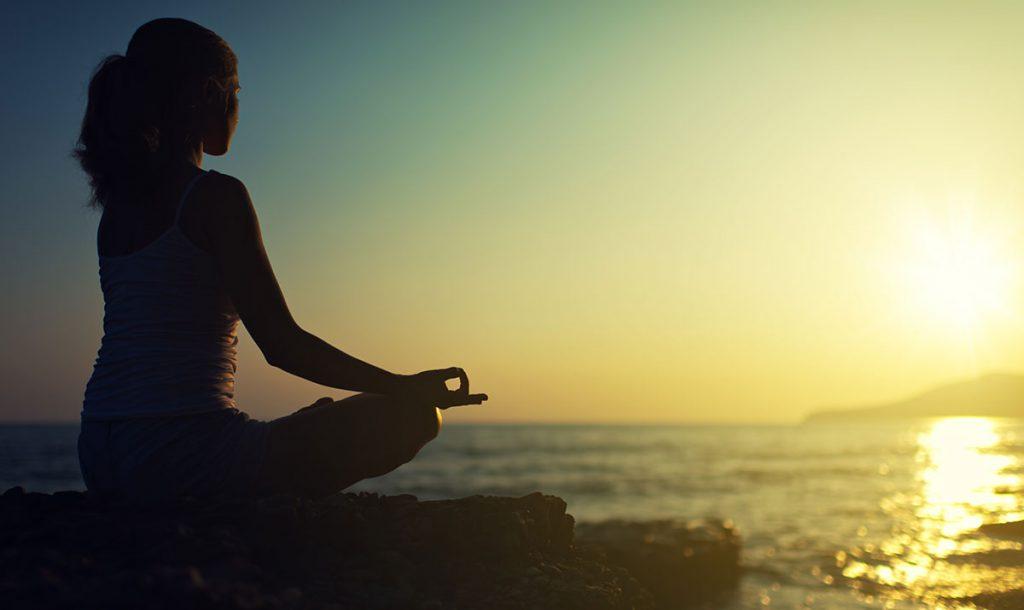 woman-practicing-oceanside-yoga