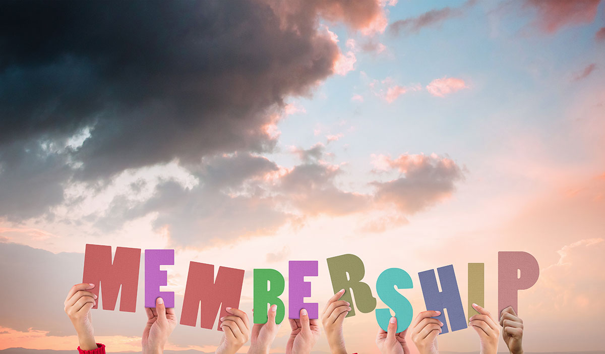 people holding up letters that form the word membership