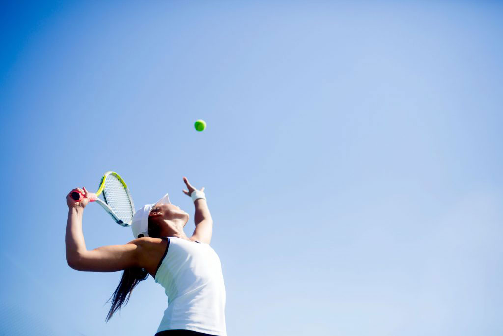 Image of a woman playing tennis, one of the club amenities on Seabrook Island