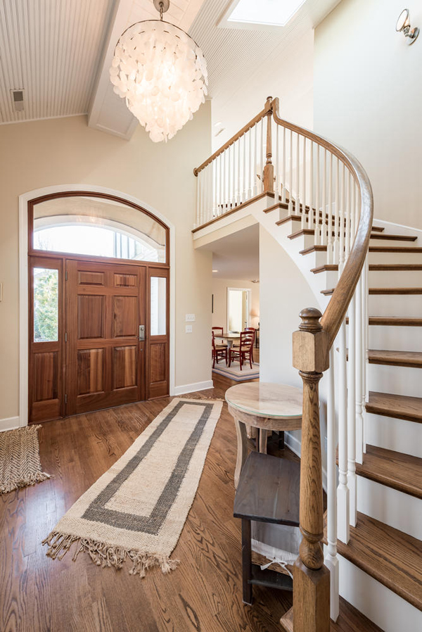 interior picture of beach house with staircase and foyer