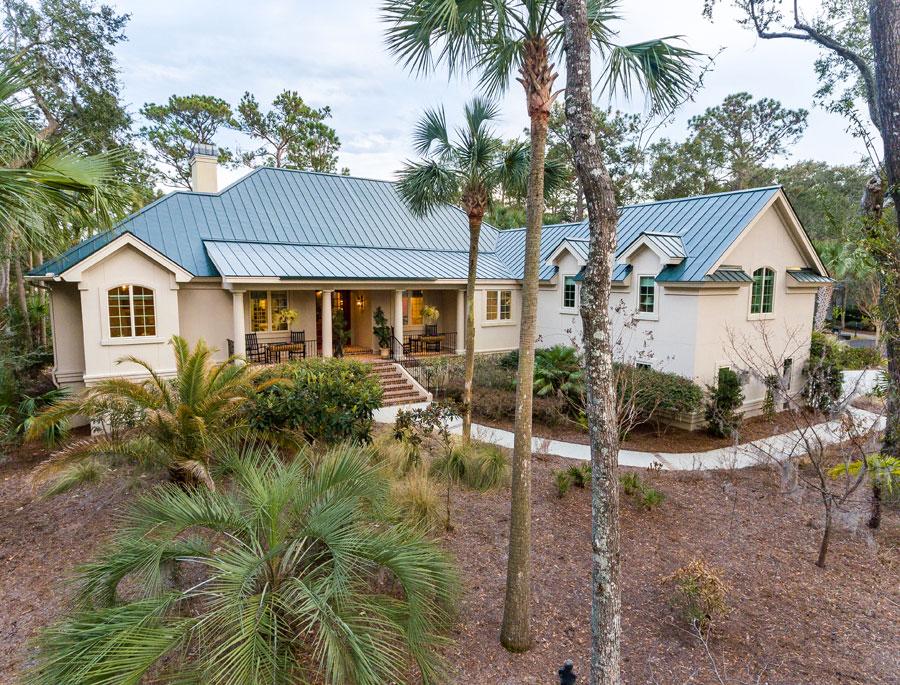 seabrook island home with palm trees