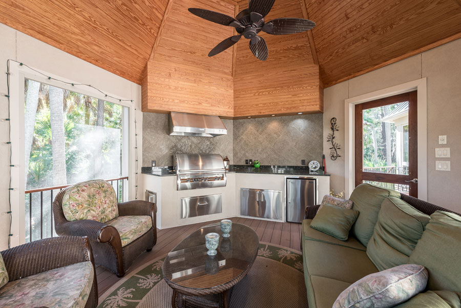 backyard indoor space with small kitchen and couch