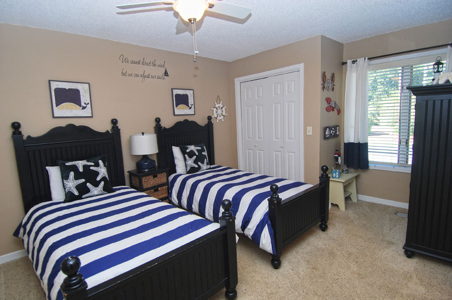 beach house bedroom with two single beds