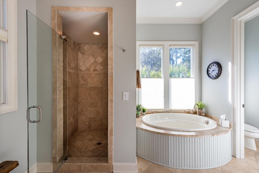 seabrook island home bathroom with shower and tub