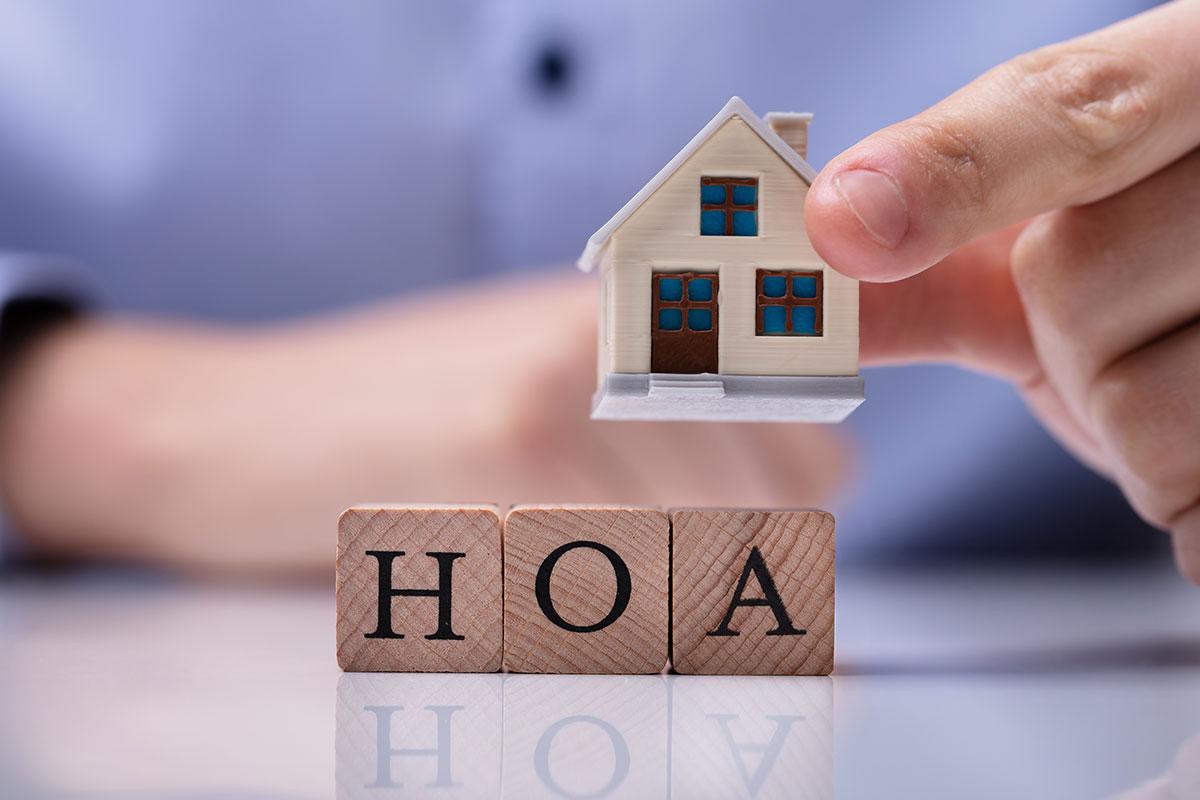 man deciding whether to purchase a house in an HOA neighborhood
