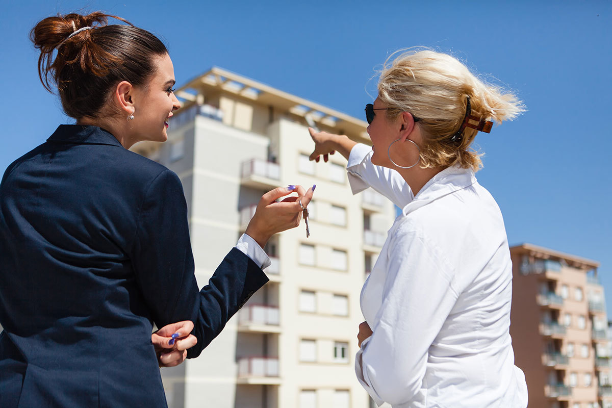 Real estate agent discussing potential home with client