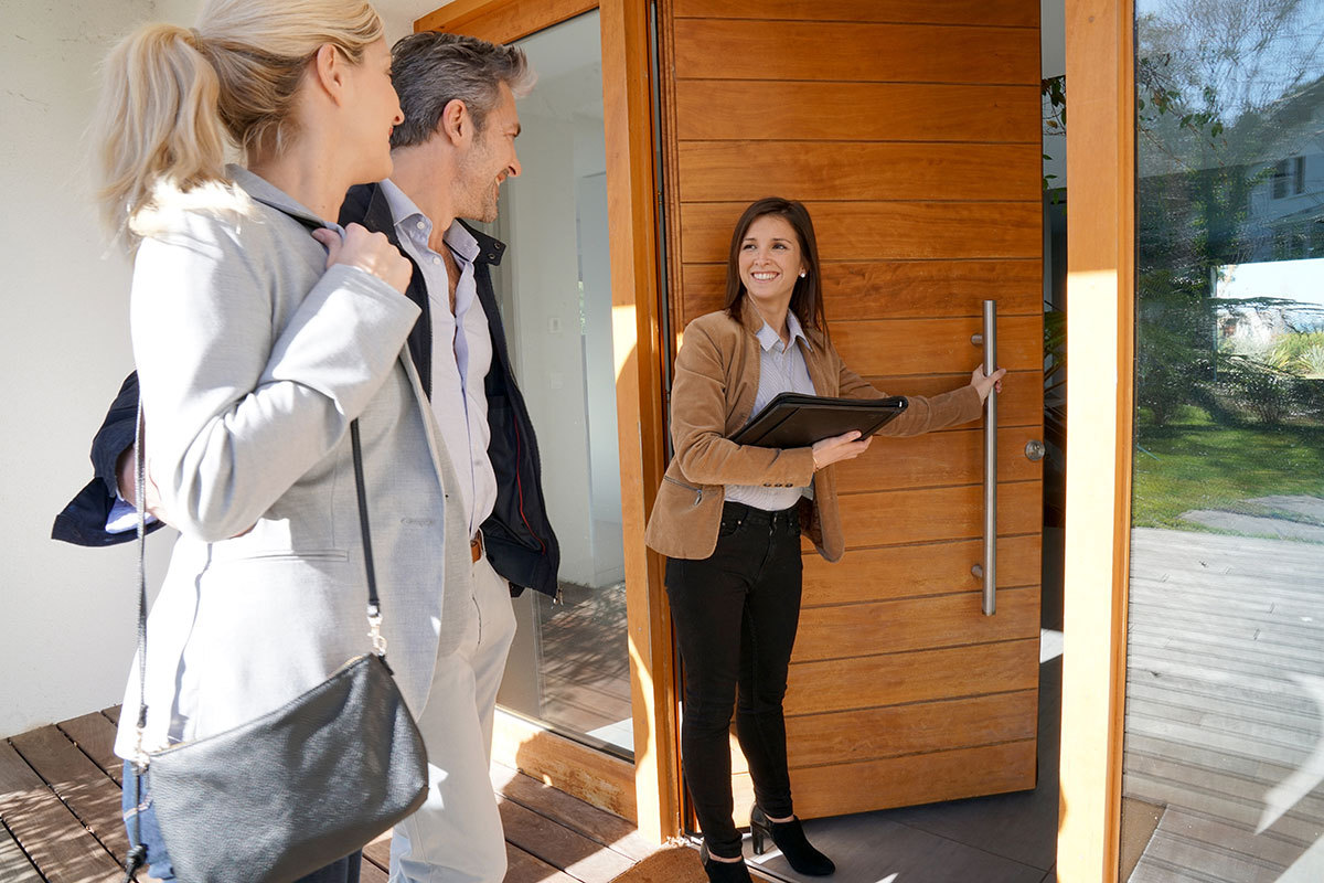 Real estate agent showing home to couple wanting to purchase home