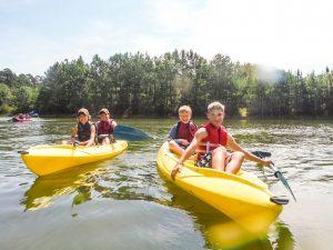 boys in yellow kayaks