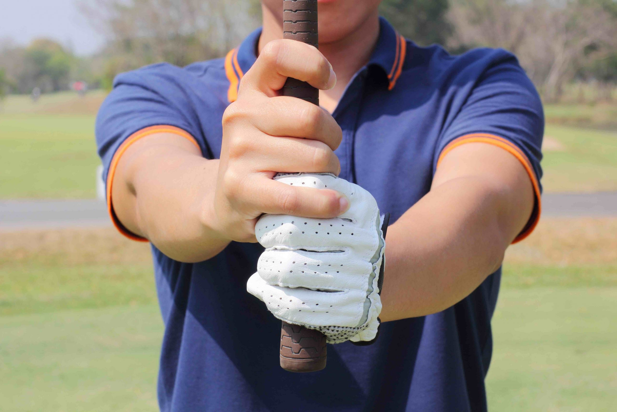 golfer holding golf club with both hands