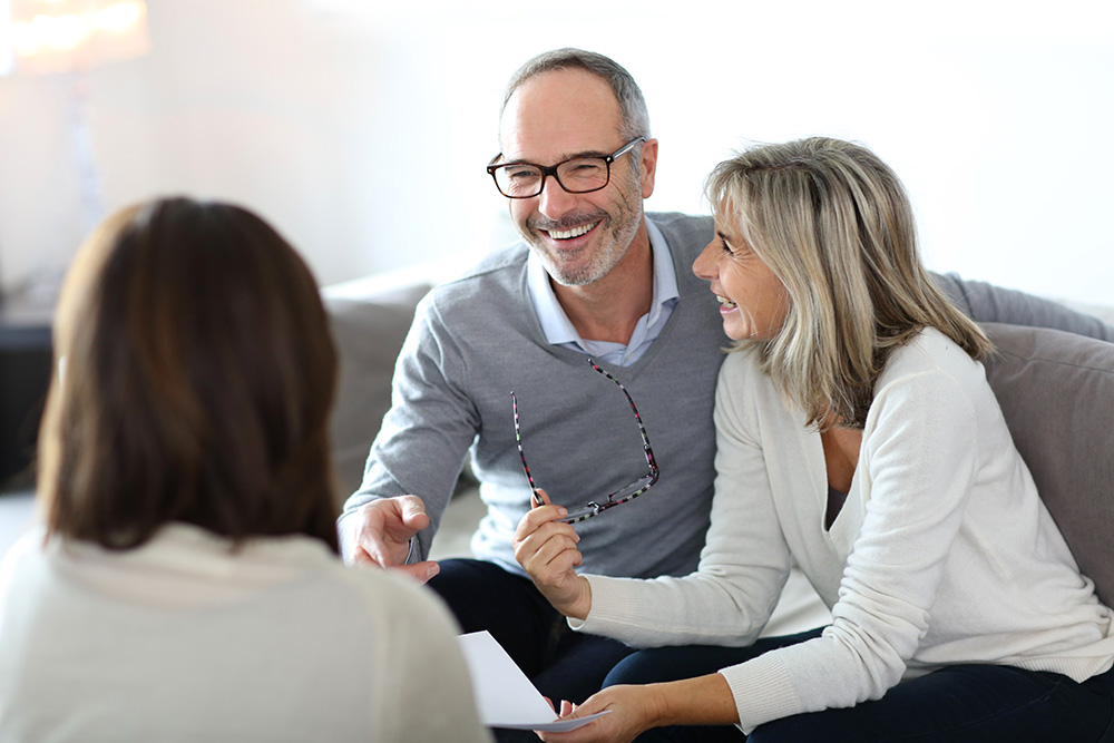 couple talking with Seabrook Island Real Estate agent