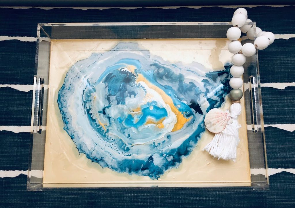 Blue Moon Art piece that resembles a blue and sea green oyster shell, complete with beige beading on the end